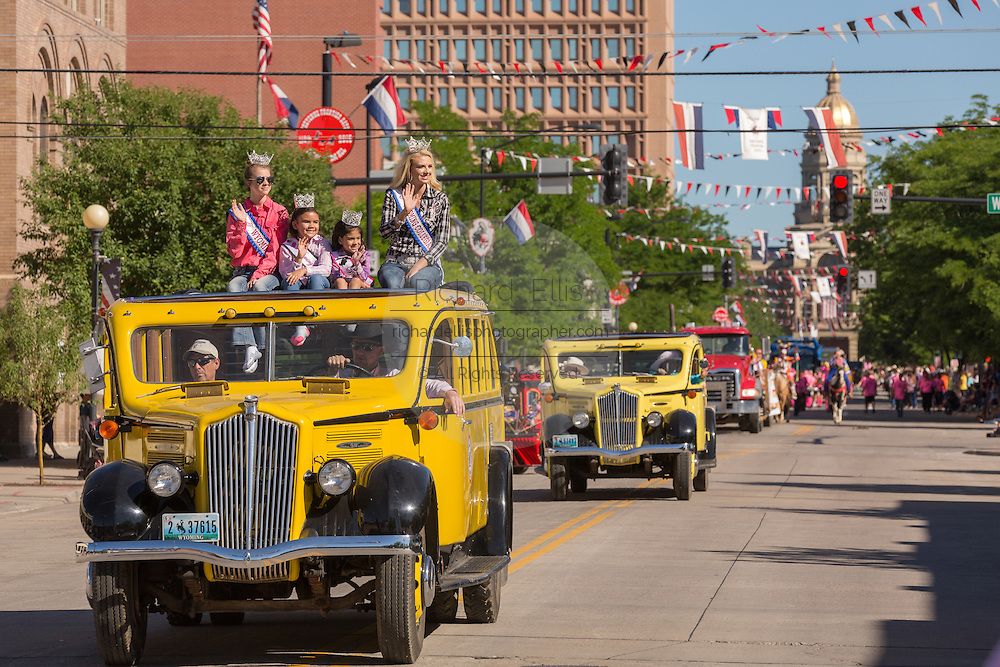 Beauty Queens wave from old buses during the Cheyenne Frontier Days parade past the state capital building July 23, 2015 in Cheyenne, Wyoming. Frontier Days celebrates the cowboy traditions of the west with a rodeo, parade and fair.
