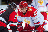 KELOWNA, CANADA - NOVEMBER 9: Radel Fazleev #19 of Team Russia faces off against Brayden Point #19 of Team WHL on November 9, 2015 during game 1 of the Canada Russia Super Series at Prospera Place in Kelowna, British Columbia, Canada.  (Photo by Marissa Baecker/Western Hockey League)  *** Local Caption *** Radel Fazleev; Brayden Point;
