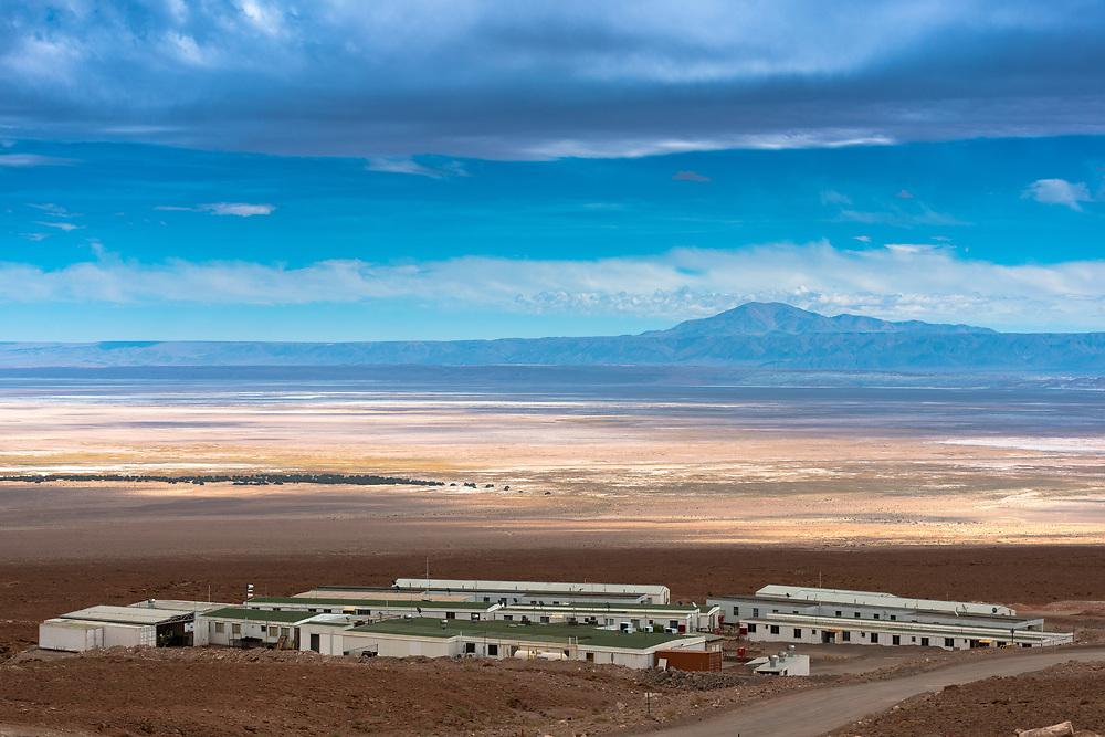 San Pedro de Atacama, Atacama Desert, ALMA Base Camp, Chile – May 7, 2015:  Part of ALMA Base Camp infrastructure and view of The Atacama Salt Lake (Salar de Atacama).
