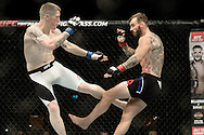 GLASGOW, SCOTLAND, JULY 18, 2015: Robert Whiteford (black shorts with white stripe) defeats Paul Redmond via TKO during UFC Fight Night 72 inside the SSE Hydro Arena in Glasgow. (Martin McNeil for ESPN)