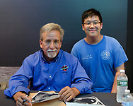 Garden City, New York, U.S. July 20, 2019. L-R, NASA Space Shuttle astronaut CHARLIE CAMARDA poses with DASHIELL CHEN, 13, at the Moon Fest Apollo at 50 Countdown Celebration at Cradle of Aviation Museum in Long Island, during the time Apollo 11 Lunar Module landed on the Moon 50 years ago. Camarda was in a summer program, for middle school STEM student s, at Mount San Antonio Community College in California, before his family relocated to Long Island.