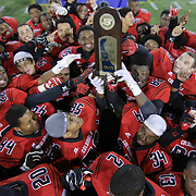 William Penn players celebrate with the DIAA State Championship trophy after William Penn defeated Middletown 42-14 for the state title Saturday, Nov. 29 2014, at Delaware Stadium in Newark Delaware.