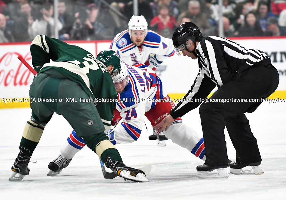 ST. PAUL, MN - MARCH 18: Minnesota Wild Right Wing Charlie Coyle (3) and New York Rangers Center Oscar Lindberg (24) face-off during an NHL game between the Minnesota Wild and New York Rangers at the Xcel Energy Center in St. Paul, MN. The Rangers defeated the Wild 3-2.(Photo by Nick Wosika/Icon Sportswire)