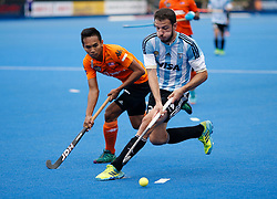 Juan Lopez of Argentina (right) and Fitri Saari of Malaysia during the Men's World Hockey League, semi-final match at Lee Valley Hockey Centre, London.