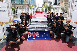 ADELAIDE, AUSTRALIA - OCTOBER 13:  Team members of UNSW Solar Racing Team vehicle 'Sunswift Violet' from Australia celebrate at the finish line on Day 6 of the 2017 Bridgestone World Solar Challenge at Victoria Square on October 13, 2017 in Adelaide, Australia. Teams from across the globe are competing in the 2017 World Solar Challenge - a 3000 km solar-powered vehicle race between Darwin and Adelaide. The race begins on October 8th with the first car expected to cross the finish line on October 11th.  (Photo by Daniel Kalisz/Getty Images for SATC) (Credit Image: © 2017 Bridgestone World Solar C/Xinhua via ZUMA Wire)