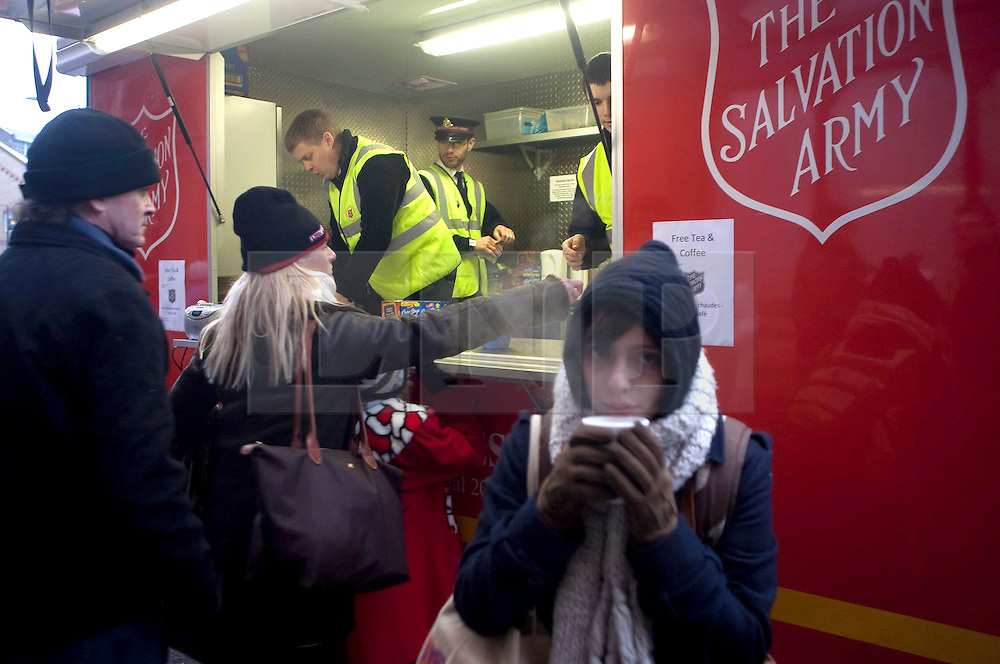 ©London News Picures. 2010/12/21. TODAY PICTURE. The Salvation Army's emergency vehicle serves hot drinks to waiting passengers. St Pancras International, EuroStar Terminal. Passengers continue to queue for their trains, The winter weather is continuing to cause problems for travellers across the UK. Photo credit should read Fuat Akyuz/London News Pictures.