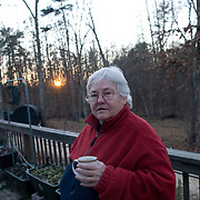 "Winnie Adams, 66, stands on the porch of her home at Alapine, a ""womyn's land"" or lesbian intentional community, in rural northeast Alabama. ..(*the exact town/location of the community cannot be revealed in the caption or article, per agreement with the subjects)..Photo by Angela Jimenez for The New York Times .photographer contact 917-586-0916"