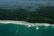 Aerial view of white waves coming to Zapatilla Cay shore. Bocas del Toro archipelago, Panama, Caribbean, Central America.