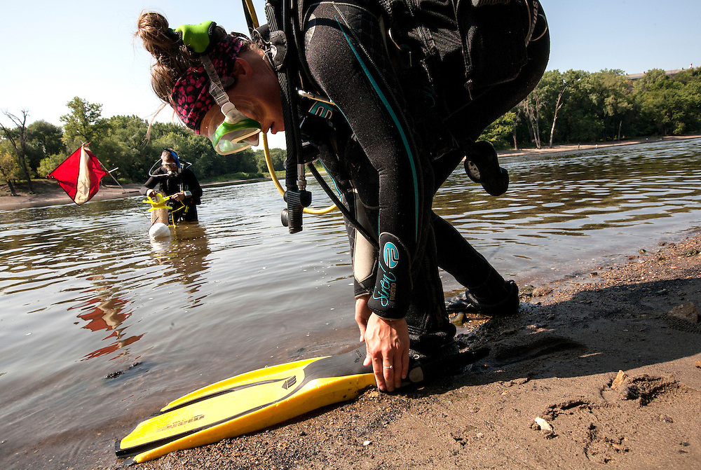 National Park Service biologists Allie Holdhusen, right, and Byron Karns prepare to dive for mussels in the Mississippi River near Pike Island August 14, 2015. They are working with a team to assess the health of all mussels in the river.