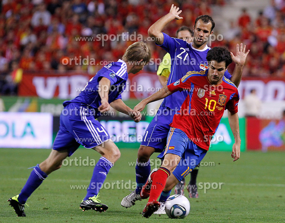 06.09.2011, Logrono, ESP, UEFA EURO 2012, Qualifikation, Spanien vs Lichtenstein, im Bild Spain's Cesc Fabregas (r) and Liechtenstein's Martin Rechsteiner (l) and Marco Ritzberger (b) during Euro 2012 qualifier match.September 6,2011.. EXPA Pictures © 2011, PhotoCredit: EXPA/ Alterphoto/ Acero +++++ ATTENTION - OUT OF SPAIN/(ESP) +++++