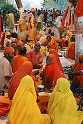 Pilgrims resting near the Shipra River during Kumbh Mela festival, Ujjain, Madhya Pradesh, India. The Kumbh Mela festival is a sacred Hindu pilgrimage held 4 times every 12 years, cycling between the cities of Allahabad, Nasik, Ujjain and Hardiwar.  Participants of the Mela gather to cleanse themselves spiritually by bathing in the waters of India's sacred rivers. Past Melas have attracted up to 70 million visitors. (Supporting image from the project Hungry Planet: What the World Eats.).