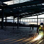 Construction worker welding on site in Birmingham