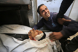 May 5, 2019 - Deir Al-Balah, Gaza Strip - A relative of two Palestinians killed in an Israeli airstrike mourns at the morgue of al-Aqsa hospital. The conflict between Israel and Gaza factions entered its second day Sunday, after a night that saw the first Israeli fatality  (Credit Image: © Mahmoud Khattab/APA Images via ZUMA Wire)