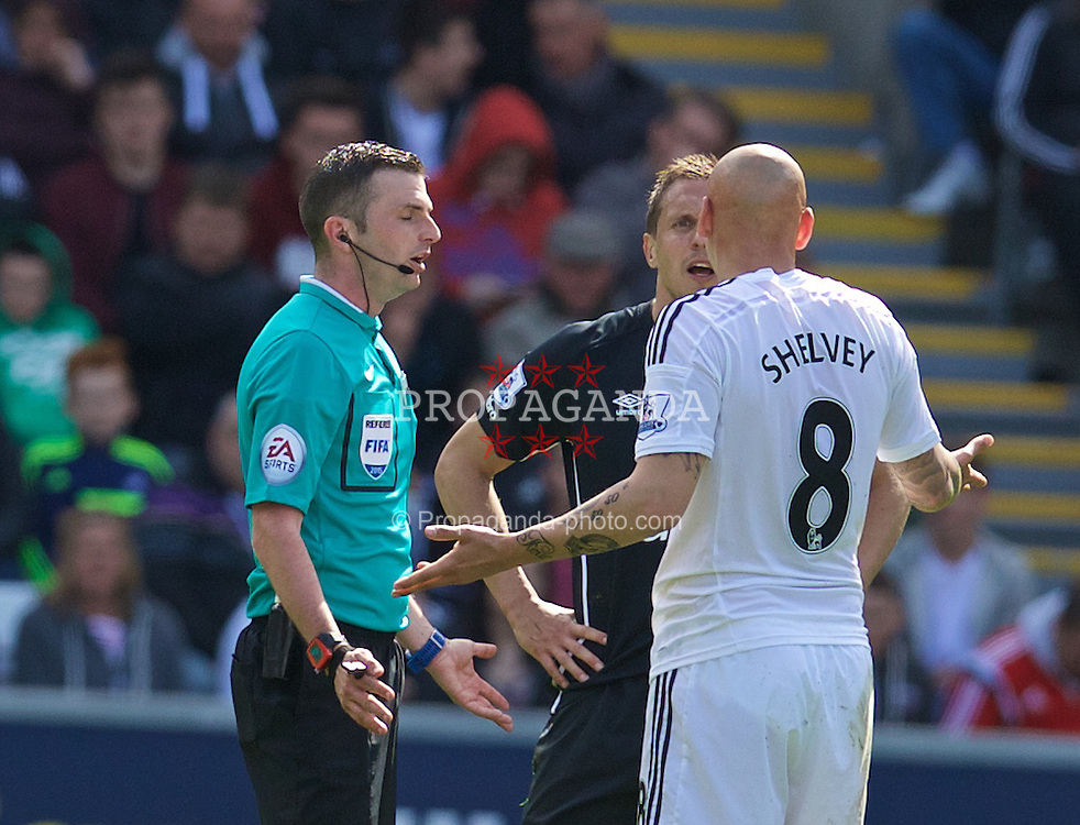 SWANSEA, ENGLAND - Saturday, April 11, 2015: Everton's captain Phil Jagielka and Swansea City's Jonjo Shelvey clash during the Premier League match at the Liberty Stadium. (Pic by David Rawcliffe/Propaganda)