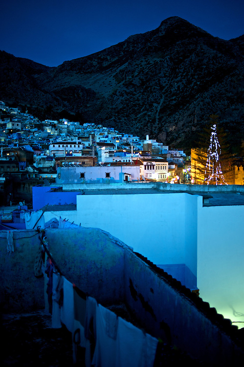 The town of Chaouen as seen at night from a rooftop in the medina.