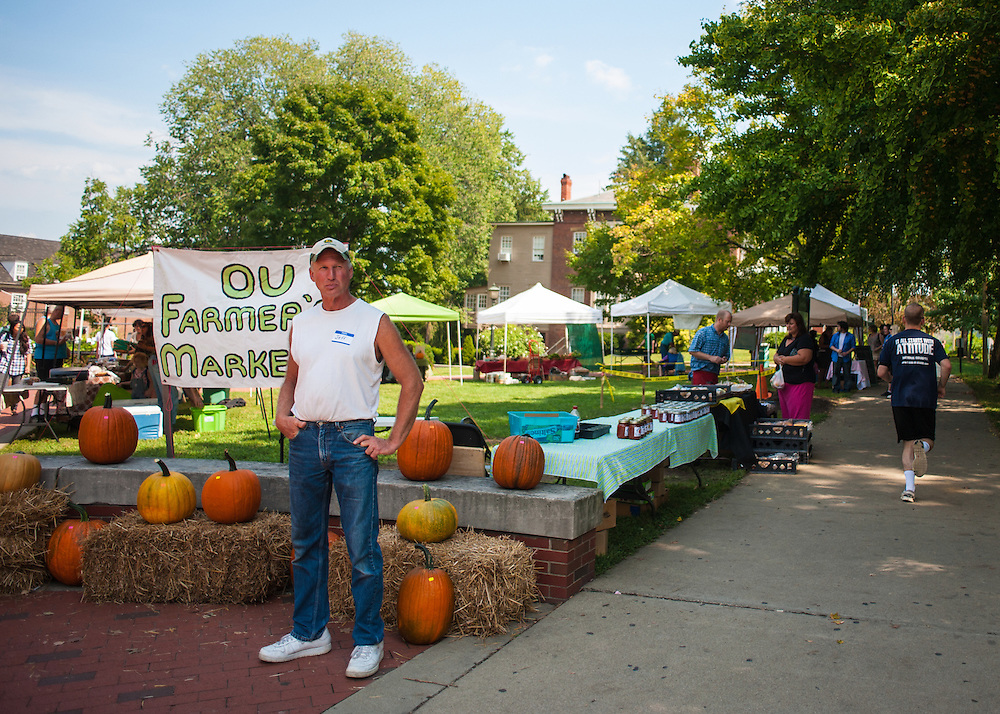 Jeff Latta stands at the corner of Howard Park where he is selling pumpkins as part of the OU Mini Farmer's Market on Friday, September 7, 2012. Photo by Julia Moss