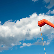 September 9, 2012 - Brooklyn, NY : Once New York City's municipal airport, Floyd Bennett Field is now administered by the Parks Department as a recreation site. The old runways remain -- providing ideal space to ride bikes and fly model airplanes.  Pictured here, a wind sock floats above the old tarmac. CREDIT: Karsten Moran for The New York Times