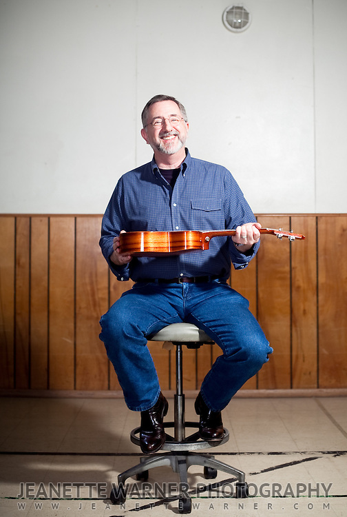 People pose with their ukulele for a portrait session in Austin, Texas.<br />