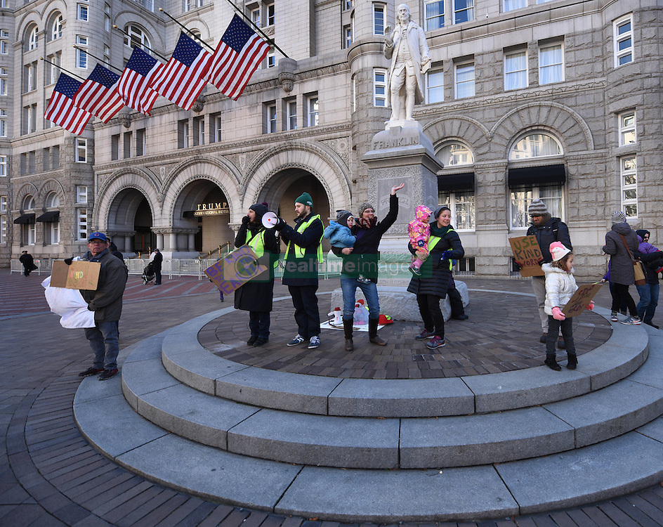 """December 10, 2016 - Washington, DC, USA - People attend rally. Children's Rally for Kindness takes place at Trump International Hotel in Washington DC on December 10, 2016 organized by the Takoma Parents Action Coalition.  According to their FaceBook page, it was a call to President-elect Donald Trump: ''to remember these lessons as he prepares to take office and implement policies that will affect the lives of children and families across our diverse nation.''.''All over the world, across cultures and countries, children learn the same basic lessons: .Ã'be kind,Ã"""" .Ã'tell the truth,Ã"""" .Ã'be fair,Ã"""" .Ã'respect everyone,Ã"""" .Ã'treat others the way you want to be treated,Ã"""" .Ã'donÃ•t touch others if they donÃ•t want to be touched. (Credit Image: © Carol Guzy via ZUMA Wire)"""
