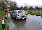 © Licensed to London News Pictures. 29/12/2012. Laleham, UK. A car ignores road closed signs next to the flooded River Thames in Laleham.  Flooding along the River Thames today 29th December 2012.Forecasters say the UK can expect heavy rain and winds the coming days. Photo credit : Stephen Simpson/LNP