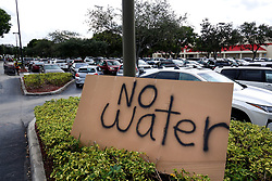 September 5, 2017 - Palm Beach Gardens, Florida, U.S. - A sign in the Costco parking lot in Palm Beach Gardens off of Northlake Boulevard tells customers they are sold out of water during preparation for hurricane Irma. (Credit Image: © Richard Graulich/The Palm Beach Post via ZUMA Wire)