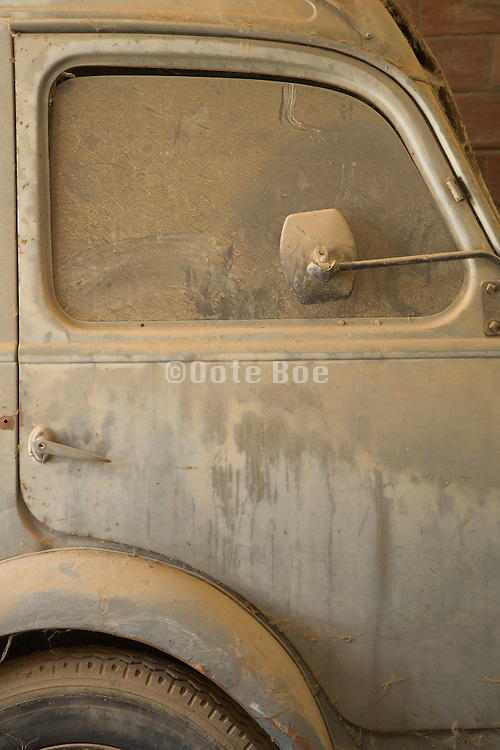 old truck with a lot of dust