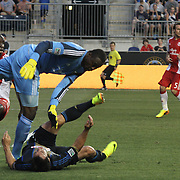 Portland Timbers Keeper Donovan Ricketts (1) collides with Philadelphia Union Midfielder Daniel Cruz (44) in the first half a MLS regular season match Saturday, July. 20, 2013 at PPL Park in Chester PA.