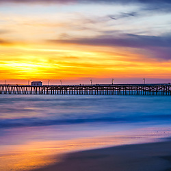 San Clemente pier sunset panorama photo. San Clemente is a popular beach city in Southern California in the United States of America. Panorama photo ratio is 1:3. Copyright ⓒ 2017 Paul Velgos with all rights reserved.