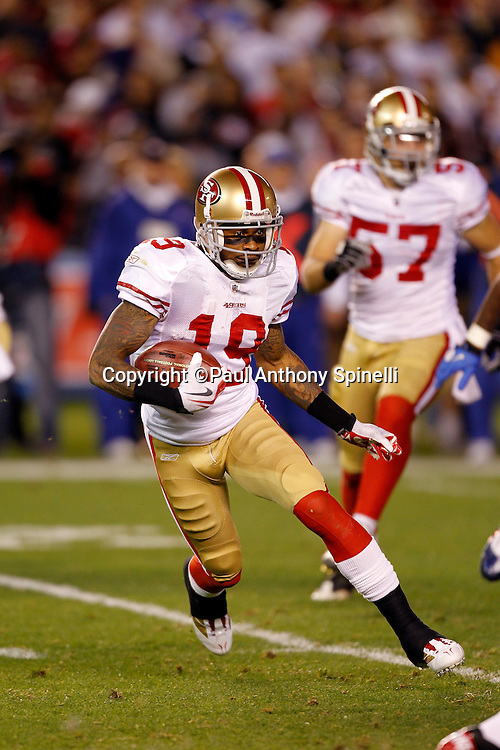San Francisco 49ers kick returner Ted Ginn Jr. (19) returns a kickoff during the NFL week 15 football game against the San Diego Chargers on Thursday, December 16, 2010 in San Diego, California. The Chargers won the game 34-7. (©Paul Anthony Spinelli)