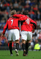 Arm in arm, Ruud Van Nistelrooy celebrtates scoring his 3rd goal for Manchester United with goal provider David Beckham. Manchester United v Charlton Athletic, FA Premiership, 3/05/2003. Credit: Colorsport / Matthew Impey