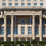 Detail of front facade with balcony intended for speeches. The Palace of the Parliament (Also known as Ceausescu's Palace or House of The People) in Bucharest, Romania. Built 1983-1989. Architect: Anca Petrescu