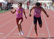 Mar 24, 2018; Los Angeles, CA, USA; Alexander Barnum of Southern California (left) defeats Zach Bazile of Oiho State to win the 100m, 10.36 to 10.40, during the Power 5 Trailblazer challenge at Cromwell Field.