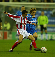 Photo. Aidan Ellis.<br />Wigan Athletic v Stoke City.<br />Nationwide Division 1.<br />14/10/2003.<br />Wigan's Jimmy Bullard and Stoke's Lewis Neal