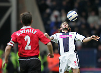 Photo: Lee Earle.<br /> West Bromwich Albion v Manchester United. The Barclays Premiership. 18/03/2006. Albion's Jonathan Greening (R) controls the ball as Gary Neville approaches.