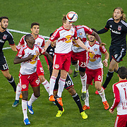 Nov 8, 2015; Harrison, NJ, USA; New York Red Bulls midfielder Dax McCarty (11) heads the ball during the second  half of the MLS Playoffs at Red Bull Arena. Mandatory Credit: William Hauser-USA TODAY Sports