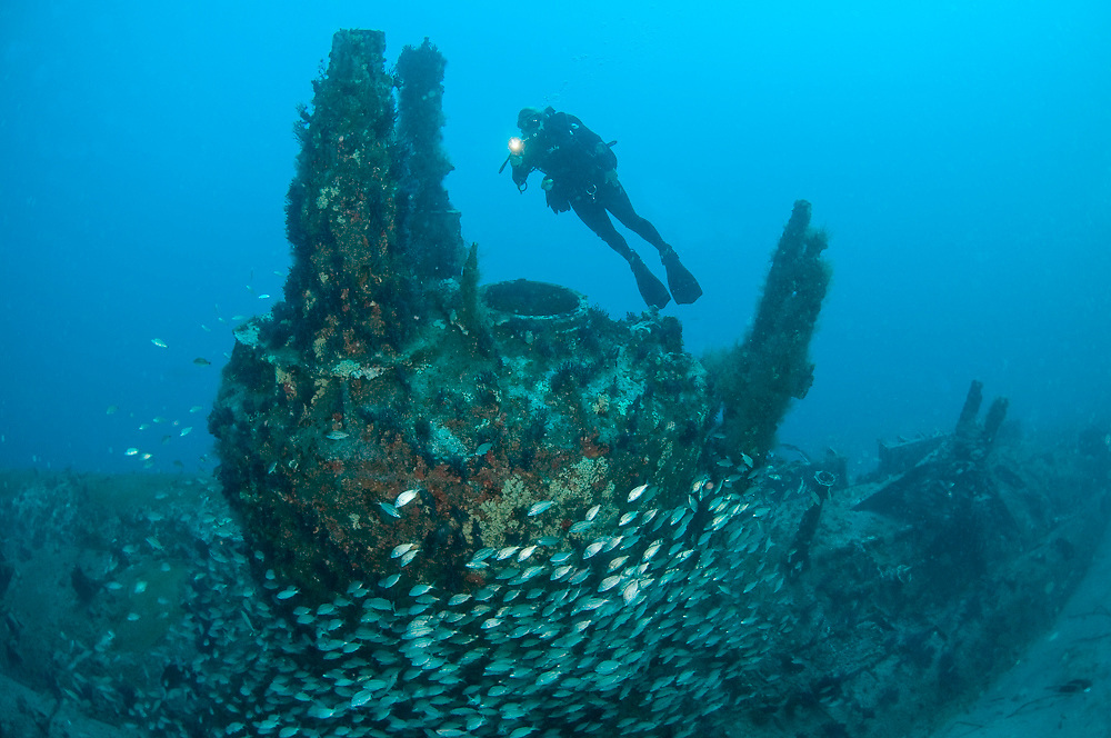 Scuba diver swims over the the wreck of the U-352 offshore North Carolina, United States.