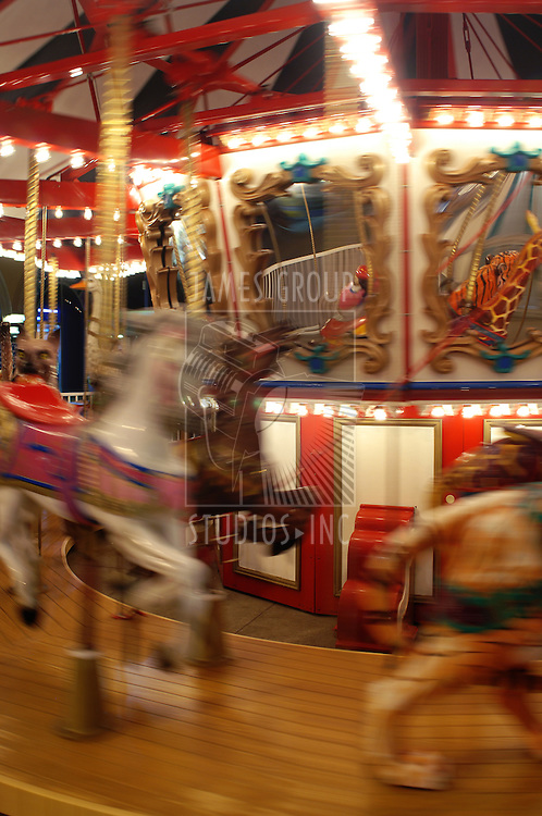 Carnival carousel in motion with blur