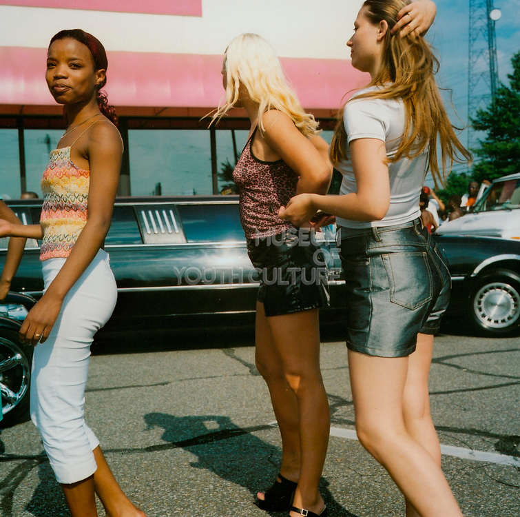 US girls standing in a car park