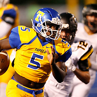 Thomas Wells | Buy at PHOTOS.DJOURNAL.COM<br /> Tupelo running back Jaquerrious Williams runs away from several hernando defenders as the Golden Wave ran away with a 31-0 win for Homecoming.