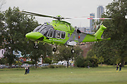 A Children's Air Ambulance takes-off from Ruskin Park in Lambeth, south London, on 21st June 2019, in London, England. The AgustaWestland AW169 helicopter G-TCAA is operated by used by UK Air Ambulances Specialist Aviation Services whose UK headquarters are at Gloucestershire Airport in England. It was built in 2016.