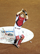 May 19 2011; Phoenix, AZ, USA; Arizona Diamondbacks catcher Miguel Montero (26) catches a foul ball hit by Atlanta Braves batter Alex Gonzalez (not pictured) during the fifth inning against the Atlanta Braves at Chase Field. Mandatory Credit: Jennifer Stewart-US PRESSWIRE