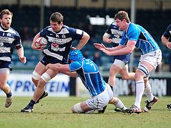 Bristol Winger (#14) George Watkins is tackled by Leinster 'A's Flanker (#7) Rhys Ruddick - Photo mandatory by-line: Dougie Allward/JMP - Tel: Mobile: 07966 386802 07/04/2013 - SPORT - RUGBY - Memorial Stadium - Bristol. Bristol v Leinster A - B&I Cup.