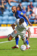 Coventry City forward Jonson Clarke-Harris (18) challenged by Gillingham FC forward Josh Parker (14) during the EFL Sky Bet League 1 match between Gillingham and Coventry City at the MEMS Priestfield Stadium, Gillingham, England on 25 August 2018.