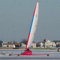 (PSTORE) Ocean Gate 1/28/2003  Larger ice boats like these Yankee boats power their way across the Toms River.  Many North Shresbury club members traveled south to the better ice offered in Toms River.   Michael J. Treola Staff Photographer...MJT