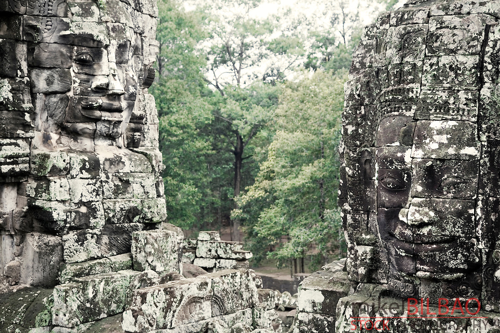 stone heads in Bayon temple. Angkor Thom.<br /> Angkor temples, Cambodia, Asia
