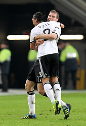 11.10.2011, Esprit Arena, Duesseldorf, GER, UEFA EURO 2012 Qualifikation, Deutschland (GER) vs Belgien (BEL), im Bild..Torjubel Mesut Özil und Per Mertesacker (beide GER) nach dem 1:0 durch Mesut Özil..// during the UEFA Euro 2012 qualifying round Germany vs Belgium  at Esprit Arena, Duesseldorf 2011-10-11 EXPA Pictures © 2011, PhotoCredit: EXPA/ nph/  Hessland       ****** out of GER / CRO  / BEL ******