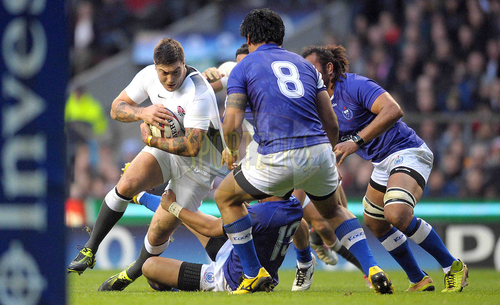 © SPORTZPICS /  SECONDS LEFT IMAGES 2010 - Rugby Union - Investec Challenge - England v Samoa - 20/11/10 - England's Matt Banahan tries to break though near the posts against three Samoan defenders - at Twickenham Stadium UK - All rights reserved