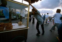 TURKEY ISTANBUL JUL02 - A street hawker pushes his cart through Eminonu bus terminal during rush-hour...jre/Photo by Jiri Rezac..© Jiri Rezac 2002..Contact: +44 (0) 7050 110 417.Mobile:   +44 (0) 7801 337 683.Office:    +44 (0) 20 8968 9635..Email:     jiri@jirirezac.com.Web:     www.jirirezac.com