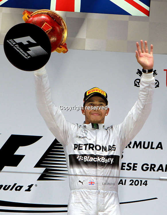 20.04.2014. SHanghai, China.  Motorsports: FIA Formula One World Championship 2014, Grand Prix of China, 44 Lewis Hamilton (GBR, Mercedes AMG Petronas F1 Team) winner of the race with his trophy on the podium