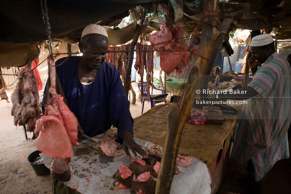 Goat butcher in the souk of the 4 sq km Abu Shouk refugee camp which is (disputedly) home to 38,000 displaced persons and families on the outskirts of the front-line town of Al Fasher (also spelled, Al-Fashir) in north Darfur.